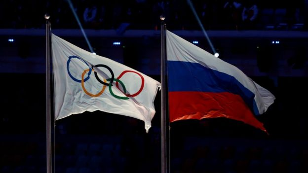 Russian and Olympic flags, file photo