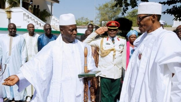 President of The Gambia Yahya Jammeh (L) welcoming President of Nigeria Muhammadu Buhari (R) at the State House in Banjul, Gambia, 13 January 2017.