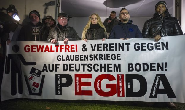 Supporters of the Pegida movement take part in a rally on December 8, 2014 in Dresden, Germany.