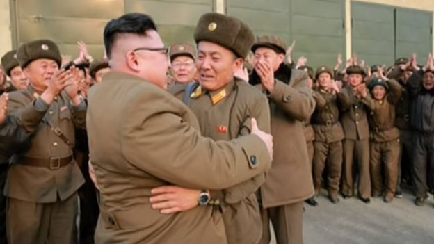Picture of Kim Jong-un embracing a military officer in a photo released on 19 March 2017