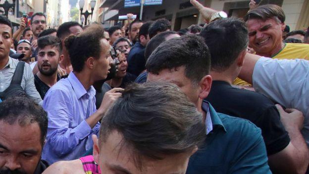 Jair Bolsonaro grimaces after being stabbed in the stomach in Juiz de Fora, Minas Gerais State, on September 6, 2018.