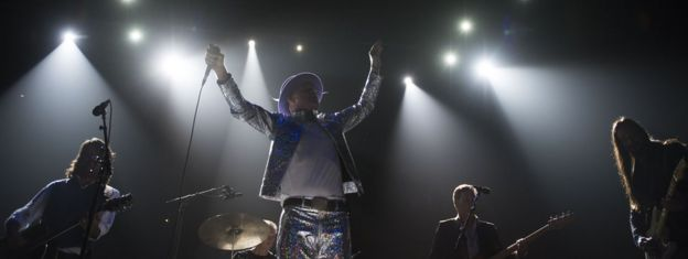The Tragically Hip performing under spotlights during their last tour. 10 August 2016