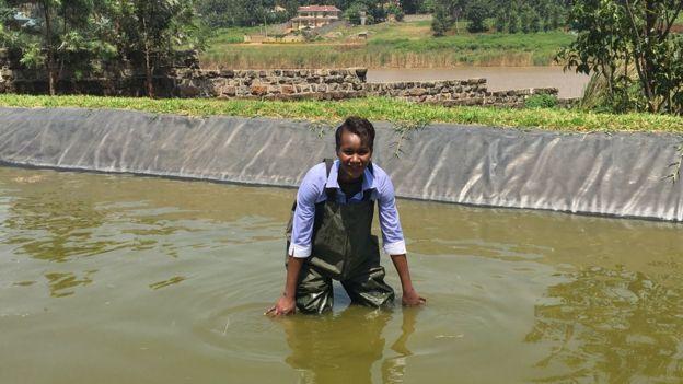 Sophie Ikenye wearing waders in the water
