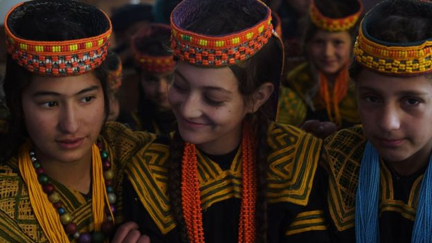 In this photograph taken on October 31, 2015, Kalash students attend a class at a school in the Brun village of Bumboret valley.