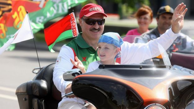 Alexander Lukashenko riding a Harley-Davidson motorcycle with his son Nikolai in his lap, in Minsk, 2009
