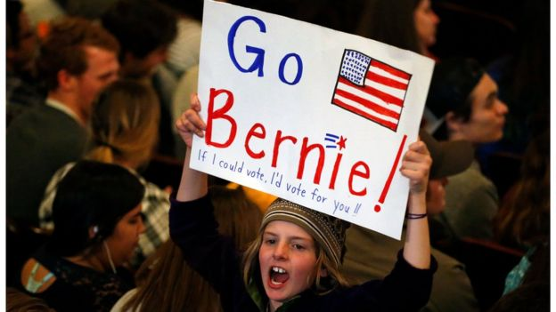 Marlow Mittelstaedt holds a sign and cheers while waiting for the arrival of Democratic presidential candidate Sen. Bernie Sanders, I-Vt.,