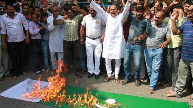 Activists of Hindu hardline origination Shiv Sena shout anti-Pakistani slogans as they burn a Pakistani flag during a protest against an attack on Indian Army camp at Uri, in Jammu, India,