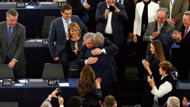 Antonio Tajani (C) from the European People
