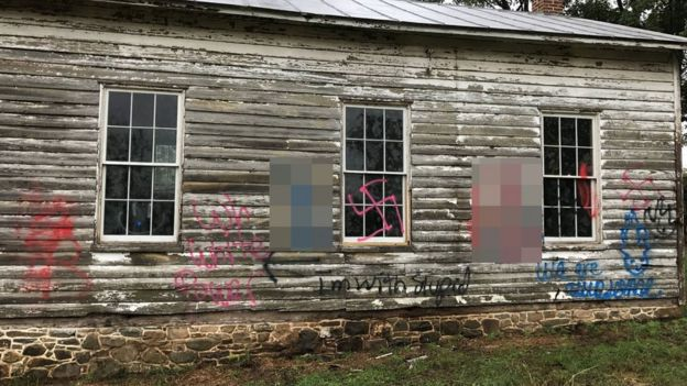 Swastikas were also painted across the windows, with another