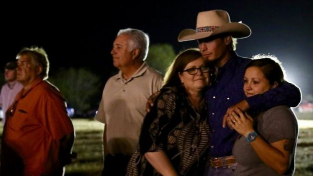 Johnnie Langendorff (2nd right) during a vigil in Sutherland Springs