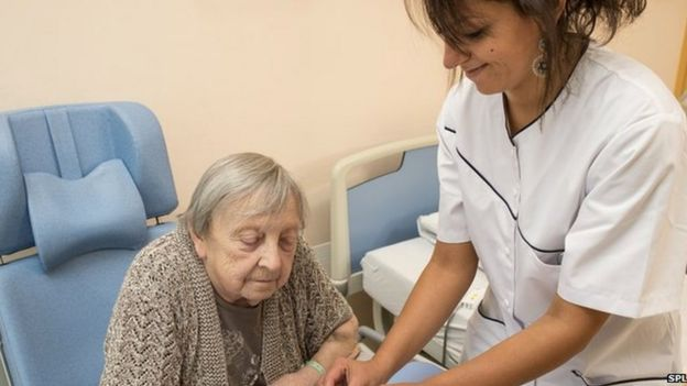 Picture of nurse caring for patient after stroke