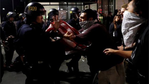 Protesters scuffle with police in Oakland, California, during a demonstration against Donald Trump, 10 November 2016