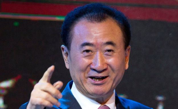In this 16 June 2016 file photo, Wang Jianlin, chairman of Wanda Group, gestures as he speaks during a signing ceremony for a strategic partnership between FIBA and Wanda Group in Beijing