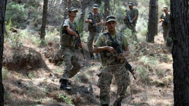 Soldiers searching woodland near Marmaris, Turkey