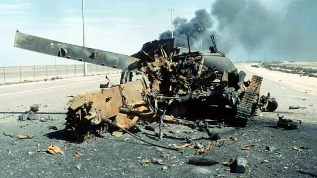 An Iraqi main battle tank on a highway south of Kuwait City destroyed in a Coalition attack during Operation Desert Storm - February 1991