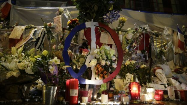 A picture taken on November 25, 2015 shows flowers and candles in front of the Bataclan theatre in memory of the victims of the November 13 attacks that left 130 dead