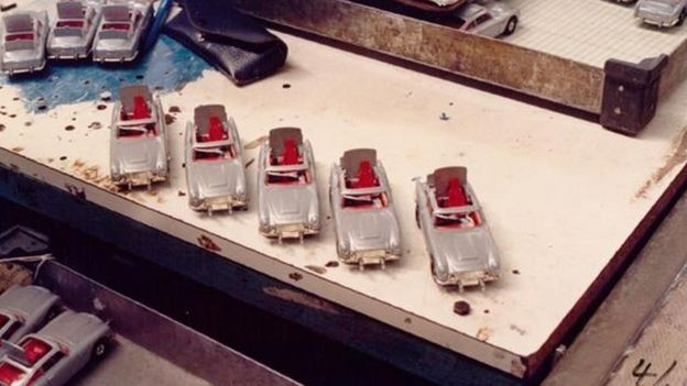 Five Aston Martin DB5's on the workbench