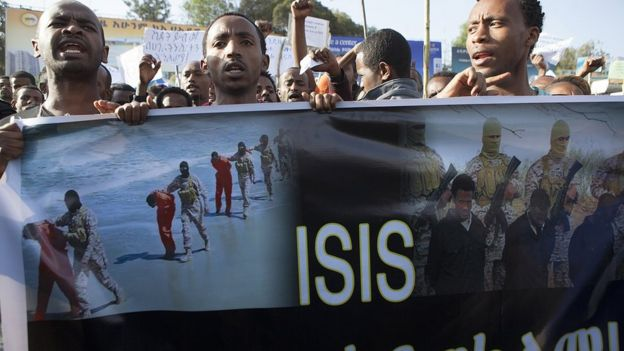 Ethiopian demonstrators in Addis Ababa hold a banner during a rally - Wednesday 22 April 2015