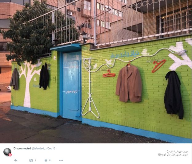 Photo of a wall with clothes hanging on it