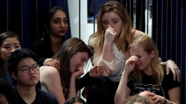 A group of women react as voting results come in at Democratic presidential nominee Hillary Clinton's election night event at the Jacob K Javits Convention Center.