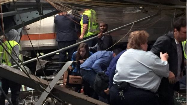 Passengers rush out of the train cars