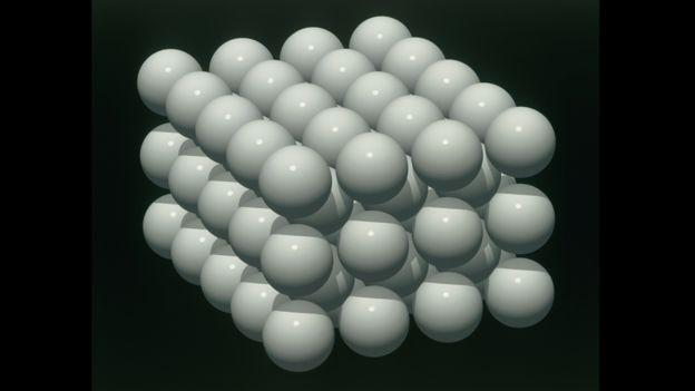 Átomos juntándose en una ilustración científica