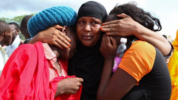 Some of the Garissa University students who were rescued, comfort each other at the Garissa military camp