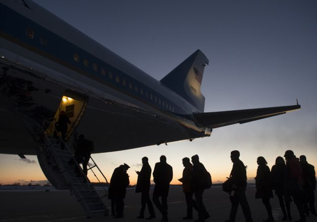 Reporters and staff board Air Force One prior to departure from Detroit Metropolitan Wayne County Airport in Romulus, Michigan, January 7, 2015