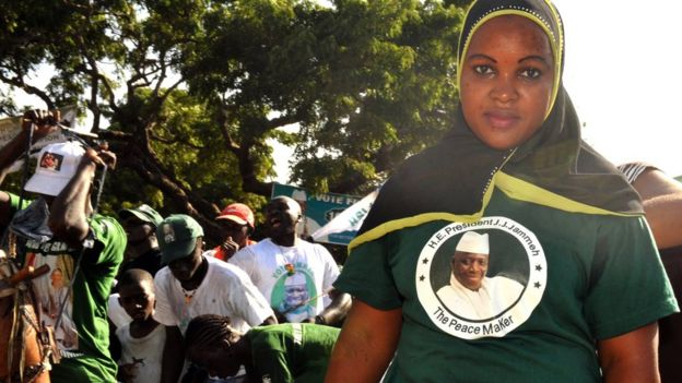 A supporter of outgoing Gambian President Yahya Jammeh wears a T-Shirt with a portrait of her candidate on November 22, 2011 during a campaign meeting in Bakau