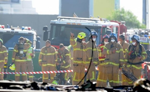 Firefighters at the scene of the crash near Essendon Airport (21 Feb 2017)