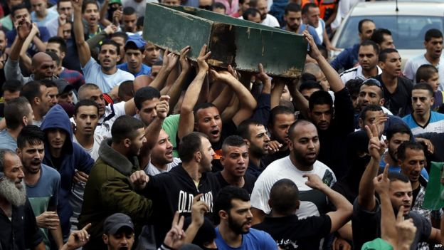 Palestinians carry body of Ahmad Qali, killed in clashes at the Shuafat refugee camp, 10 October 2015
