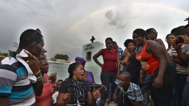 A rainbow is seen above devotees during ceremonies honouring the Haitian voodoo spirits of Baron Samdi and Gede on the Day of the Dead in Port-au-Prince, Haiti on 1 November 1, 2015