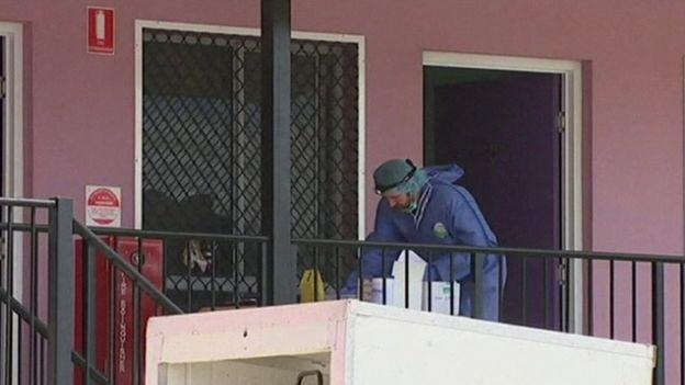 Forensic officer outside the hostel