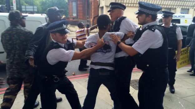 Police clash with protesters outside court in London