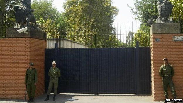 Iranian soldier stands guard in front of the main gate of the British embassy in 2003