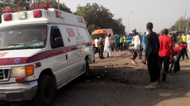 People clearing the scene after suicide attack in Maiduguri, Nigeria