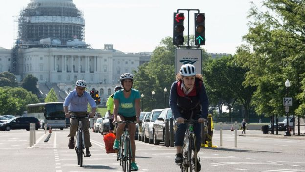 People ride bicycles past the US Capitol in Washington, DC, on May 24, 2016.