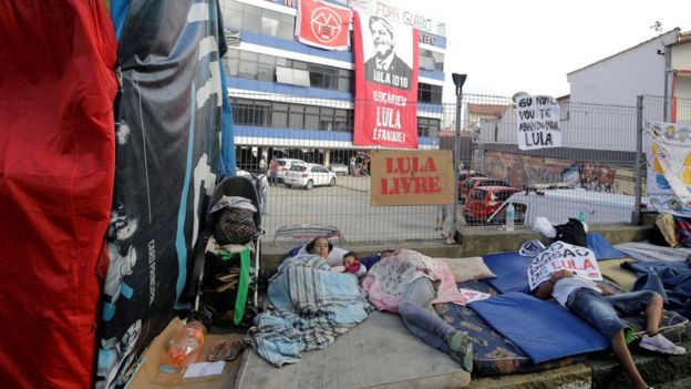 Supporters of former Brazilian President Luiz Inacio Lula da Silva sleep outside the metallurgic trade union's headquarters in Sao Bernardo do Campo, Brazil, 7 April 2018