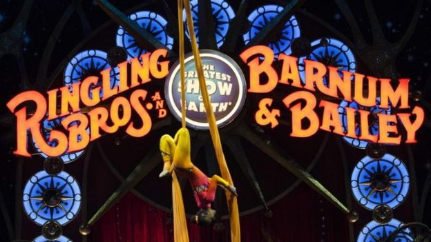 A circus performer hanging upside down during a Ringling Bros and Barnum and Bailey Circus performance in Washington DC on 19 March 2015