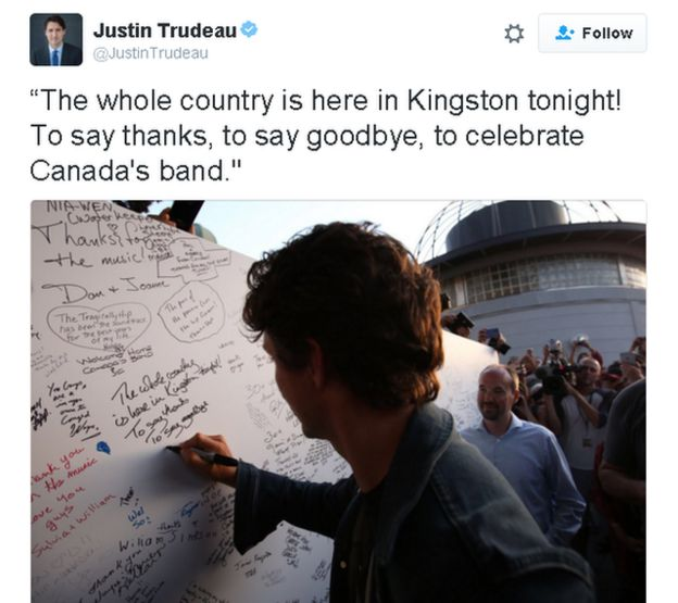 Tweet reads: The whole country is here in Kingston tonight! To say thanks, to say goodbye, to celebrate Canada's band. Photo shows Trudeau writing the same thing on a wall of messages