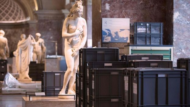 Artworks and crates in the Louvre