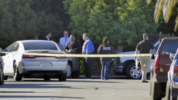 Officials investigate a home in the Lennox area of Los Angeles as they search for Lisa Marie Naegle