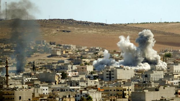 Smoke billow from the Syrian town of Kobane following an air strike by the U.-led coalition Kobane, Syria, on 21 October2014