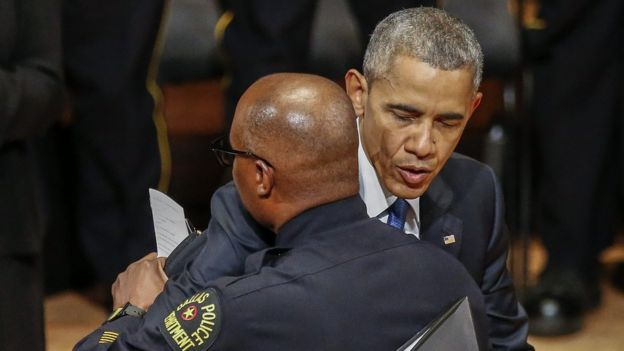 Barack Obama hugs Police Chief David Brown