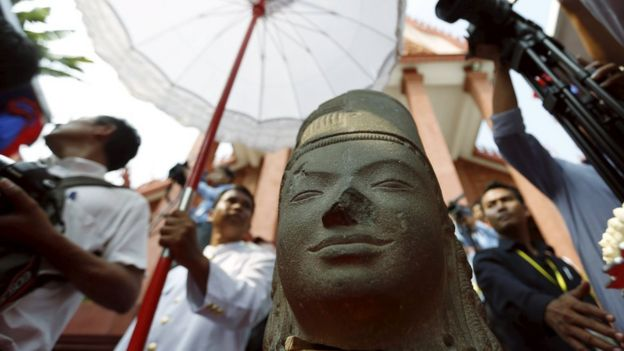 The head belonging to the Harihara statue is seen at Cambodia