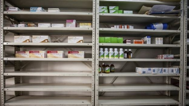 Half-empty shelves at a drugstore in Caracas, Venezuela, 14 April 2016.