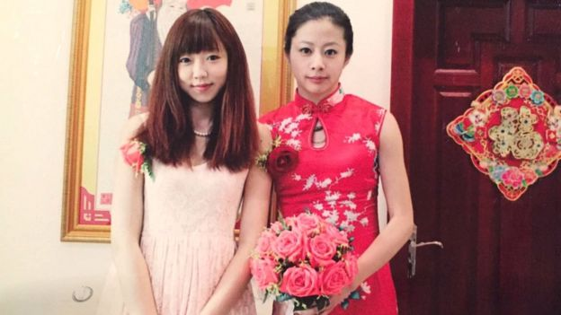Ou Xiaobai (right) in her wedding photo