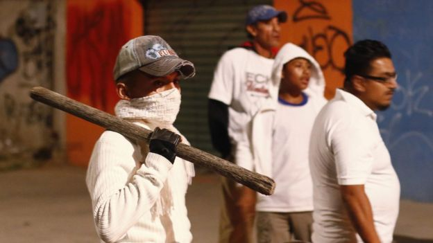 Citizens and owners of commercial premises, armed with sticks, walk through the streets as a measure of containment looting during protests over the Mexican government's decision to increase gasoline prices in Puebla, Mexico, 06 January 2017.