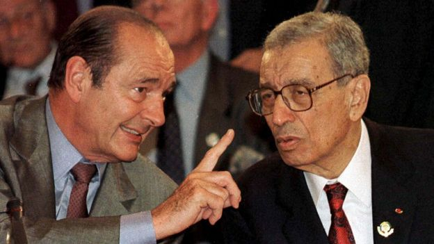 Former U.N. Secretary-General Boutros Boutros-Ghali (R) chats to then-French President Jacques Chirac (L) at the Francophone Summit in Hanoi, in this November 14, 1997