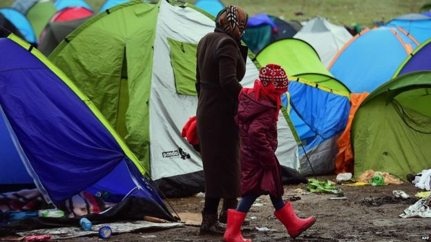 Migrants and tents near Roszke, Hungary, 11 September 2015